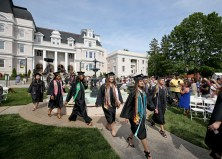 The students walk by the fountain during the processional to start the Women's College Commencement at Brenau University Friday May 4, 2018 in Gainesville, Ga. (Jason Getz for Brenau University)