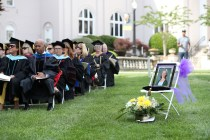 Brenau University faculty sit near an empty seat in honor of the late Jolie Long Carlton, a Brenau University professor and chair of the department of dance, during the Women's College Commencement at Brenau University Friday May 4, 2018 in Gainesville, Ga. (Jason Getz for Brenau University)