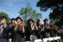 Nursing school graduates cheer on fellow nursing students as they receive their diplomas during the Women's College Commencement at Brenau University Friday May 4, 2018 in Gainesville, Ga. (Jason Getz for Brenau University)
