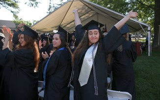 Simone Douglas turns to greet family and friends after receiving her diploma during the Women's College Commencement at Brenau University Friday May 4, 2018 in Gainesville, Ga. (Jason Getz for Brenau University)