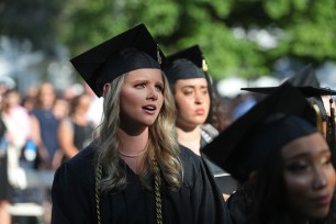 Savannah Blalock sings the alma mater during the Women's College Commencement at Brenau University Friday May 4, 2018 in Gainesville, Ga. (Jason Getz for Brenau University)