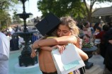 Margaret Holtkamp, facing, hugs Ella Kleinschmidt after Kleinschmidt's graduation at the conclusion of the Women's College Commencement at Brenau University Friday May 4, 2018 in Gainesville, Ga. (Jason Getz for Brenau University)
