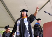 Daja Jones reacts after she receives her degree during the graduate and undergraduate commencement Saturday May 5, 2018 in Gainesville, Ga. (Jason Getz for Brenau University)