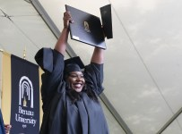Natalie Rennie reacts as she receives her degree during the graduate and undergraduate commencement Saturday May 5, 2018 in Gainesville, Ga. (Jason Getz for Brenau University)