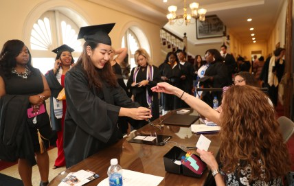 "ANU-Brenau University student Xiangqian ""Cathy"" Wu receives her tassle before the graduate and undergraduate commencement Saturday May 5, 2018 in Gainesville, Ga. (Jason Getz for Brenau University)"