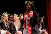 Kenya Hunter walks across the stage to receive an award at Class Day. (AJ Reynolds/Brenau University)