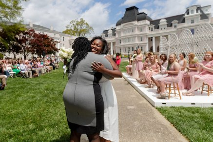 May Queen Simone Lewis gets a hug as she is introduced during May Day. (AJ Reynolds/Brenau University)