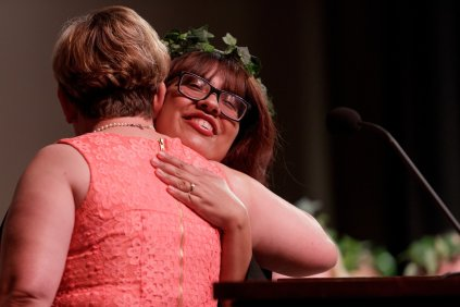 Karen Sanchez gets a hug from Tami English as she receives recognition during Class Day. (AJ Reynolds/Brenau University)