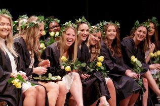 Seniors laugh as the juniors perform a skit for them during Class Day. (AJ Reynolds/Brenau University)