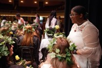 Kaiya Walker hands roses to senior class members during Class Day. (AJ Reynolds/Brenau University)