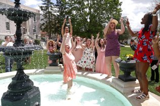 Sorority members cheer after fellow sorority member Connie Oldmixon is placed into the fountain during the May Day Celebration of the Alumnae Reunion Weekend & May Day at Brenau University Saturday, April 14, 2018, in Gainesville, Ga. Photo by Jason Getz / Brenau University