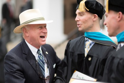 Georgia Sen. Butch Miller laughs with Ryan Ahlenius, center, one of the first graduates from Brenau University with a Doctor of Physical Therapy, following the 2018 Spring Commencement Ceremony on Saturday, May 5, on Brenau University's historic Gainesville campus. (Nick Bowman for Brenau University)