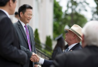 Georgia Sen. Butch Miller greets Jinze Zheng, director of the project department for Anhui Normal University, on Saturday, May 5, at the 2018 Spring Commencement Ceremony on Brenau University's historic Gainesville campus. (Nick Bowman for Brenau University)