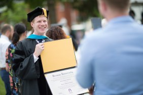 Steven Hightshue, DPT, shows off his diploma for his brother, John Hightshue, following the 2018 Spring Commencement Ceremony on Saturday, May 5, on Brenau University's historic Gainesville campus. (Nick Bowman for Brenau University)