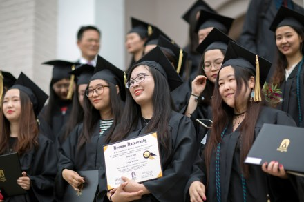 Members of the first cohort of the 2+2 partnership between Anhui Normal University and Brenau University smile with their diplomas following the 2018 Spring Commencement Ceremony on Saturday, May 5, on Brenau University's historic Gainesville campus. (Nick Bowman for Brenau University)