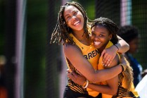 Brenau's Tyleeah Maddox, left, and Shatrice Dixon celebrate together as they compete in the triple jump Dixon won the event and Maddox placed fourth. (AJ Reynolds/Brenau University)