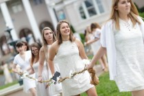 Caroline Dorr carries the daisy chain along with classmates as juniors prepare to rise to top of the Crow's Nest.
