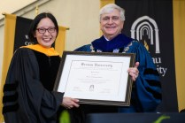 Yahlin Chang receives an honorary doctorate of humane letters presented by Ed Schrader.