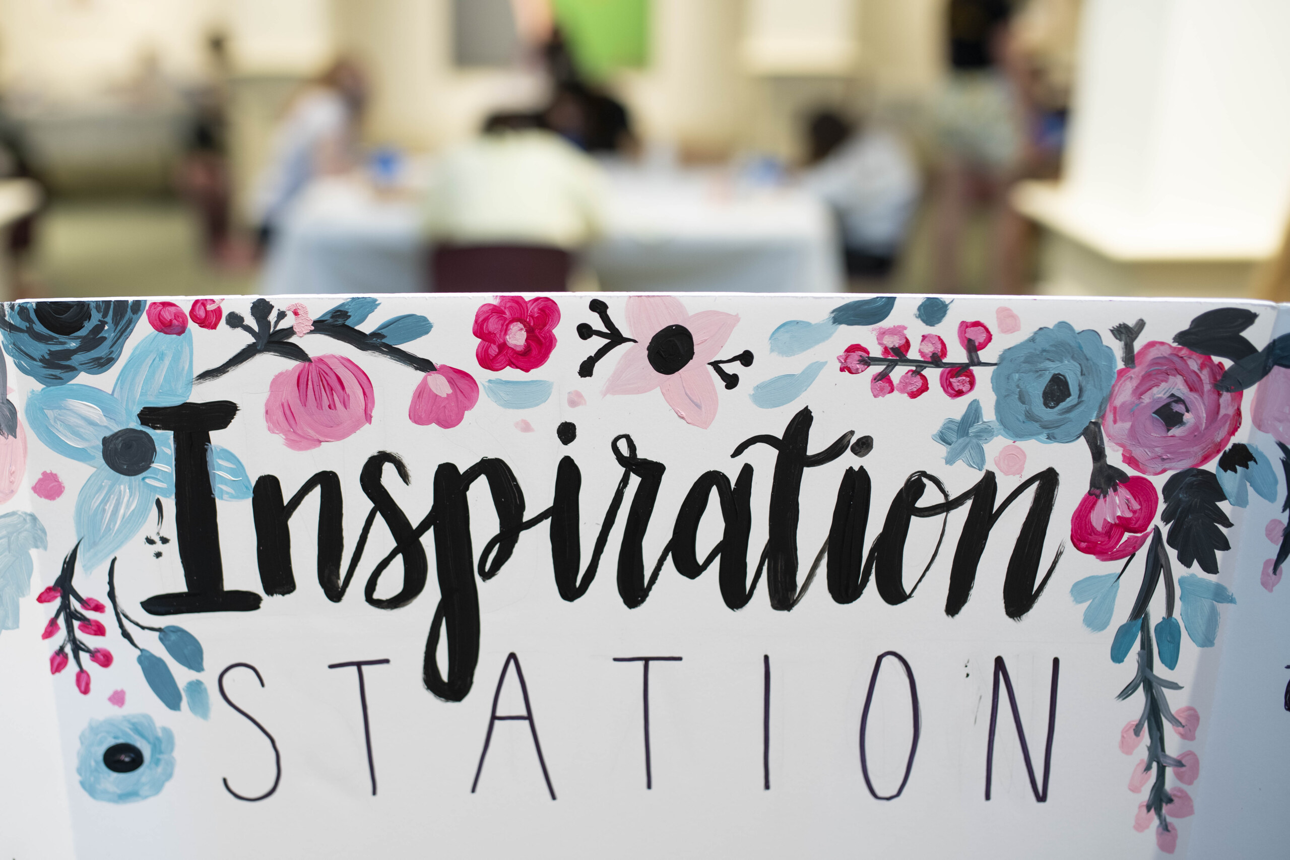 "Table card that reads ""Inspiration Station"""