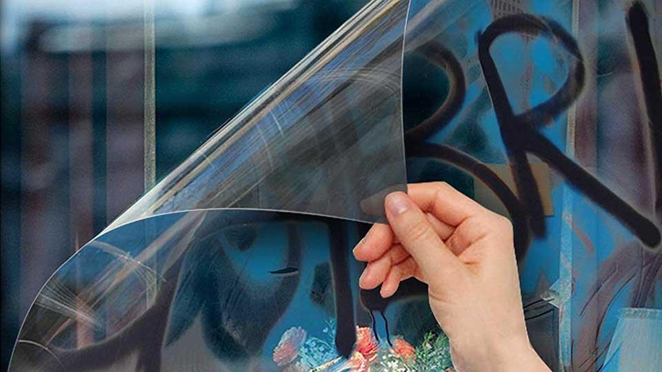 peeling graffiti film off