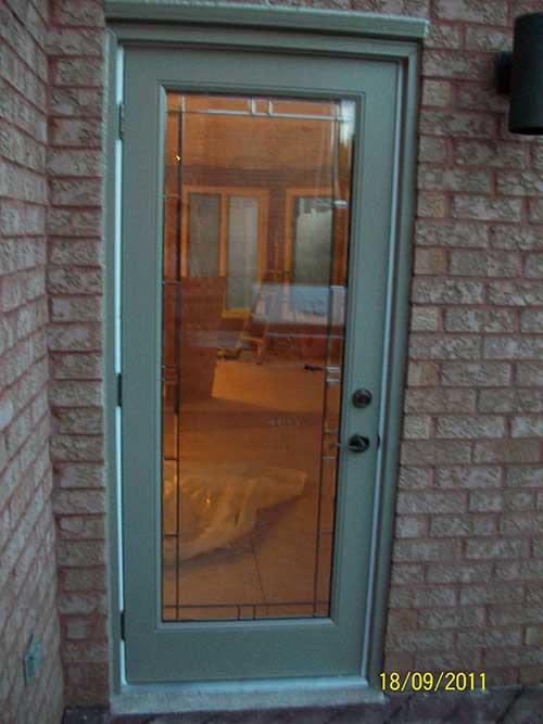 Windows and Doors TorontoSmooth Fiberglass DoorsFlush Glazed Smooth Door installation by