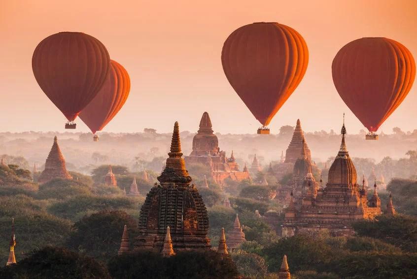 35498286 - hot air balloon over plain of bagan in misty morning, myanmar