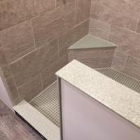 Shower seat, threshold, and half wall