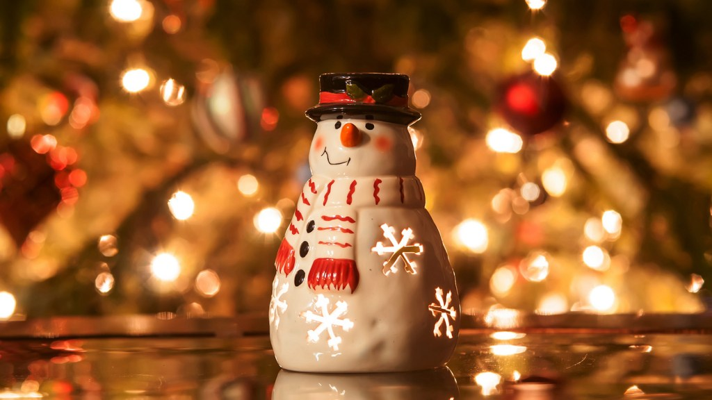 Christmas snowman with candles and ligting