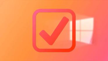 Orange-checkmark-over-windows-wallpaper-050820