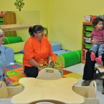 ©Ashley Thompson. Windsor Day Care Centre employees Pat Post, Klowa Bartlett and Jessica Croft entertain a re-energized Rayelle Sampson and Ivy Bethune after naptime in the infant room.