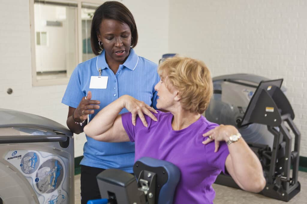Female therapist assisting a senior woman