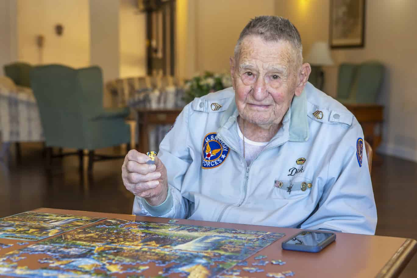 Senior man working on puzzle