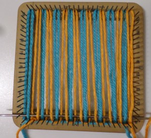 Weaving Row 1, Color 2. Note: the blue/orange sample didn't interlock the threads in the lower R corner.