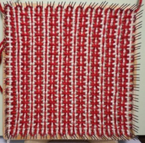 Finished square still on the loom.