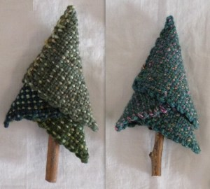 I wove the green yarn in the topmost square of the tree on the left. I wove the variegated yarn in the green trees at left. Furthermore, you can't see that the variegated is plied with black yarn, but I prepared the raw black wool and spun and plied it. :)