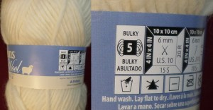 A close-up of the label shows the weight category of the yarn.