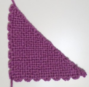 Finished triangle off the loom shows two mistakes along the hypotenuse near Cr 2.