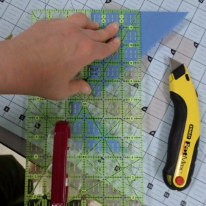 Use scraps to prop up your ruler for safer cutting.
