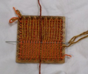 Weave over the two strands in position 16 as if they were one.