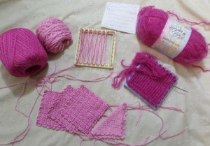The light pick yarn (second from upper left) was a bit too thin for my taste, so I'm combining it with the fuchsia crochet thread. These squares will be the body of the dress. The dark pink fluffy yarn (upper right) will be the skirt--very fancy indeed.