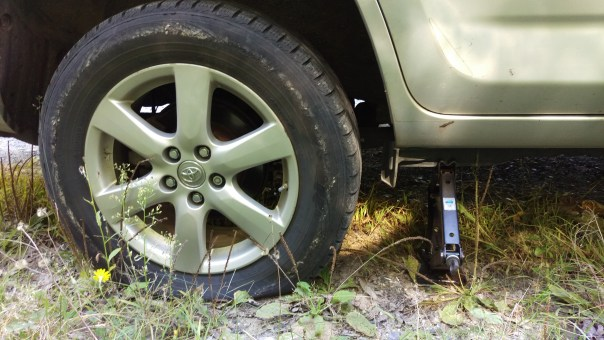 Flat tire and a car jack