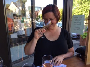 This is the least jowly photo that Jen took of me tasting wine that evening.