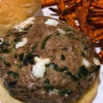 healthy homemade spinach and mozzarella turkey burgers baked in the oven with a side of carrot fries