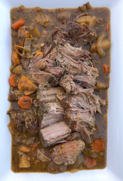An easy slow cooker pot roast recipe made with boneless chuck roast, potatoes and carrots. Comfort food made simple and flavorful.