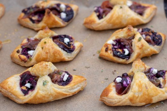 Golden and flaky easy puff pastry appetizers are filled with a sweet and savory blueberry filling, prosciutto and goat cheese. They're drizzled with honey thyme. Perfect for parties, brunch or quick snacks!