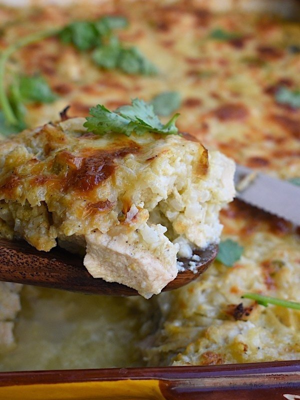 Chicken Chile verde cauliflower rice casserole is made with a base of cauliflower rice and combines classic flavors of chicken Chile verde: salsa, and cilantro in a creamy sauce.