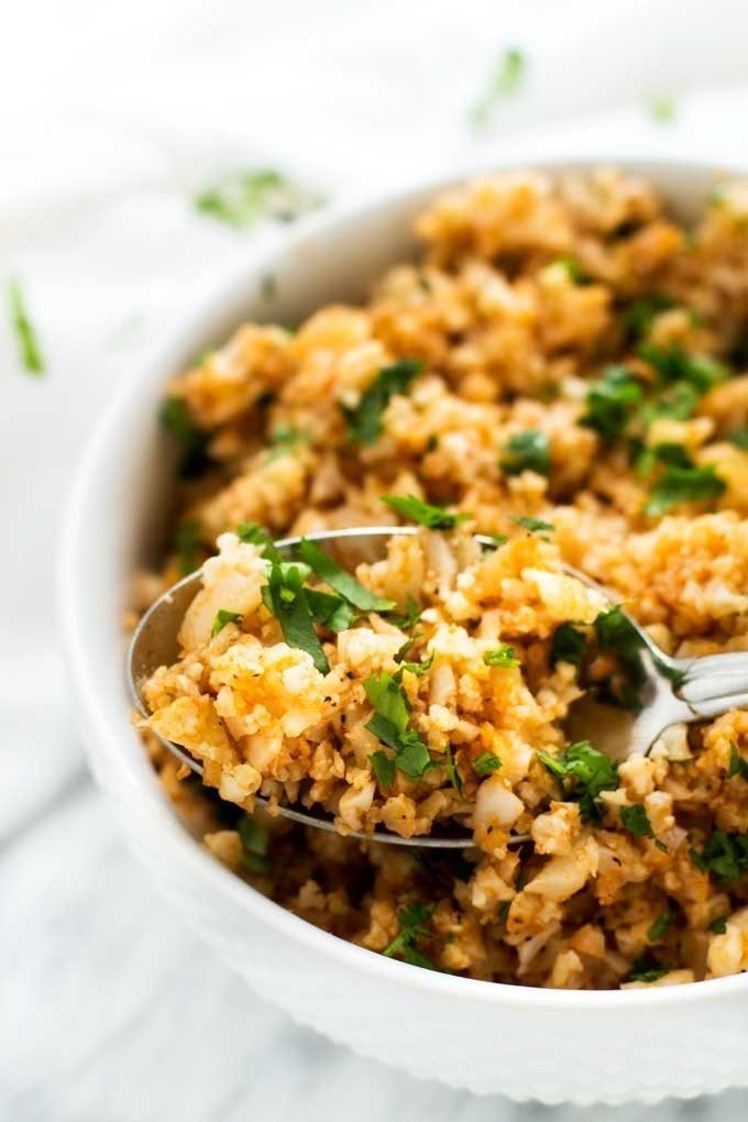 Spanish cauliflower rice is an easy to make side dish without the guilt! Gluten free, low calorie, and Keto friendly!