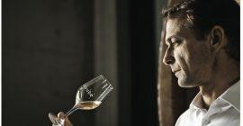 Romain Ott observing a glass of wine