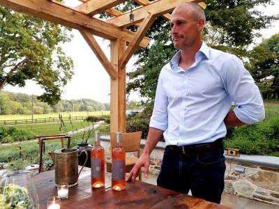 Photo Credit: Wine Casual, Vox Vineti Wines' owner and winegrower, Ed Lazzerini, pours a rosé, Discantus 2018. Wine Casual.