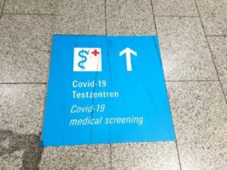 Signage at Frankfurt airport guiding visitors to COVID-19 testing center.